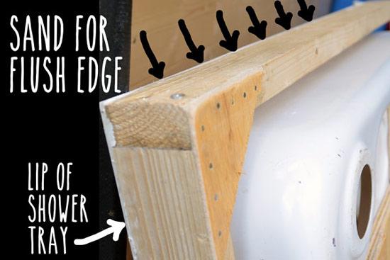 Sanding shower tray edges flush with frame