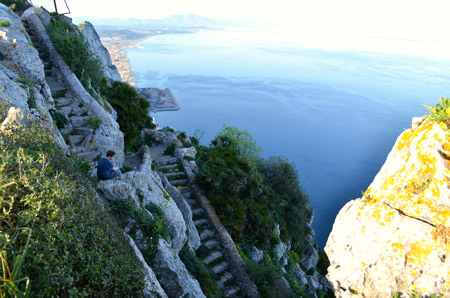 There is a kind of stepped path that takes you back down the other (East) side of the rock.