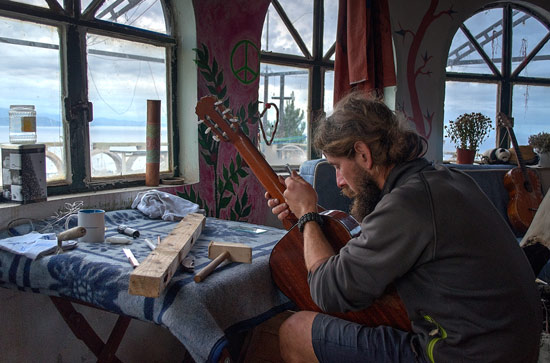 This is Christian. He travels Europe on his bike. He makes and repairs guitars, and is usually making something or playing his DIY fold-up guitar.