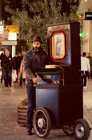 Man playing a music box on Mitropoleos Street