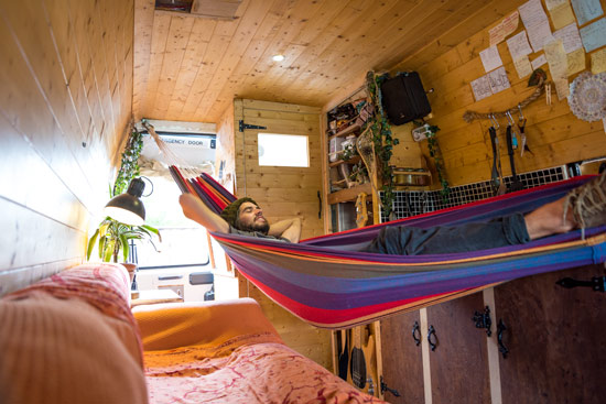 hammock-in-van-thinking-about-the-road-vanlife