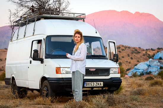 vanlife-leah-shann-in-morocco-blue-rocks-sunset