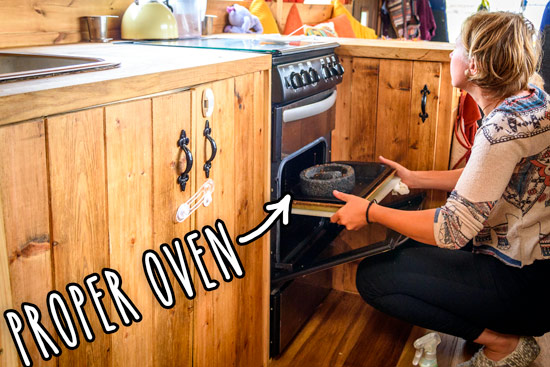 living-in-a-converted-bus-home-oven